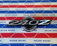 Genuine Datsun 240Z early side pillar emblems OEM NOS at The Z Shop