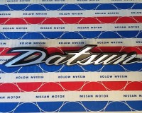 "Genuine Datsun Script ""Datsun"" Deck Lid Emblem 240Z OEM NOS at The Z Shop"